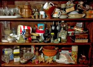 Shelves piled with clutter